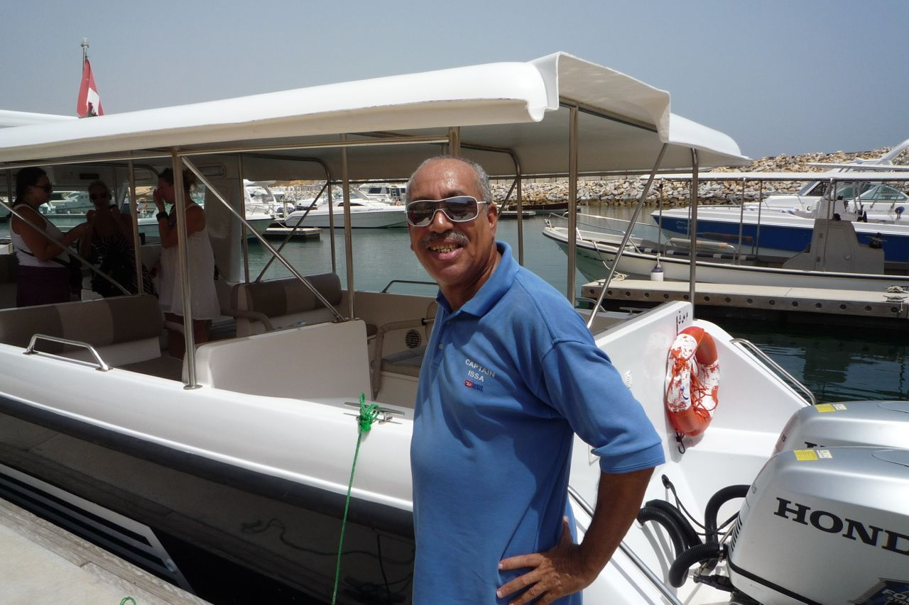 Captain of dolphin watching boat